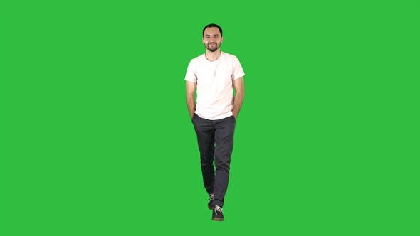 Thumbnail for Confident young adult man walking forwards and looking