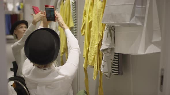 Thumbnail for Stylish Woman in Wheelchair Taking Selfie at Clothing Store