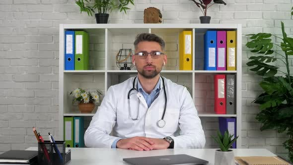 Doctor look camera listens recommendation World Health Organization on video call