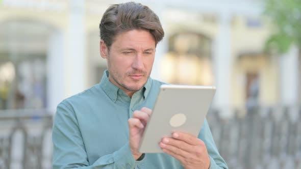 Outdoor Man using Tablet Outdoor