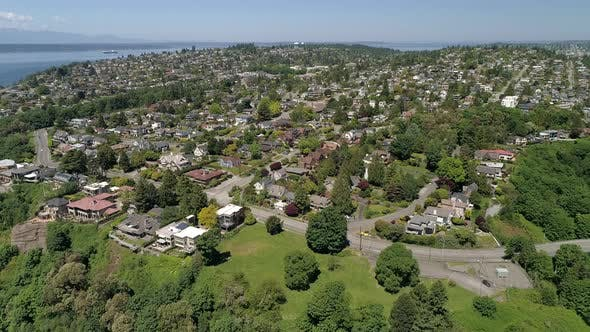 Thumbnail for Helicopter Aerial View On Sunny Day In Magnolia Neighborhood Of Seattle Washington