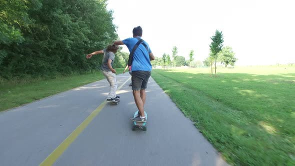 Thumbnail for Three young people skateboarding together