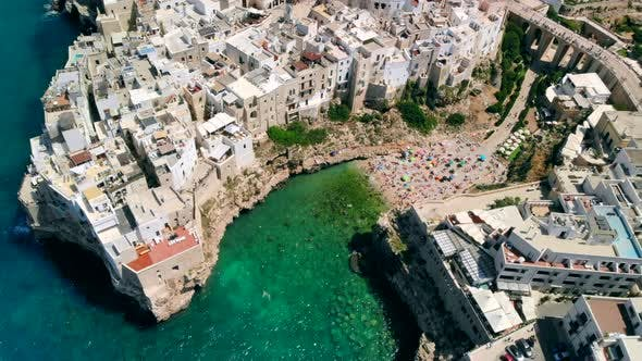 Aerial View of Sea From Polignano a Mare and Beach with Tourists, Puglia, Italy