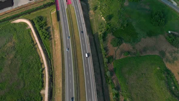 Thumbnail for Aerial Vertical Shot. Cars Driving By the Road. Traffic on the Highway.  Footage From Drone.