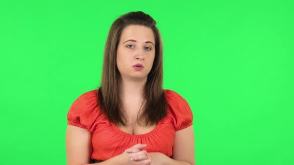 Thumbnail for Portrait of Girl Talking About Something Then Making a Hush Gesture, Secret. Green Screen