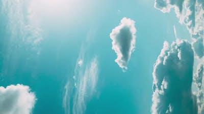 Vertical Shot Rain Clouds In Cloudy Blue Sky