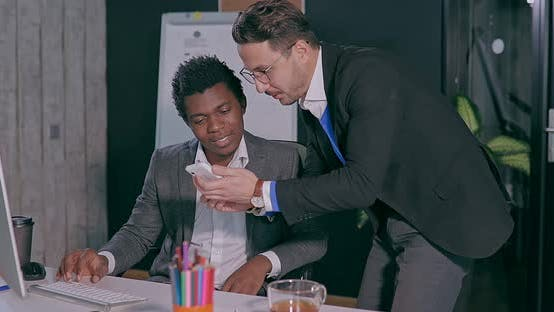 Business Man and African Meeting and Talking in the Office