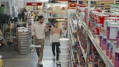 Man and Boy Shopping at Hardware Store