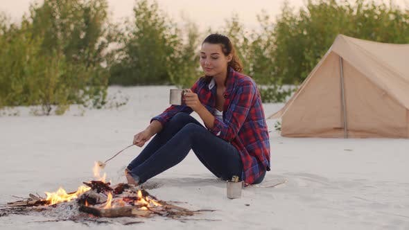 Thumbnail for Tourist Woman Camping Near Campfire Outdoors on the Nature