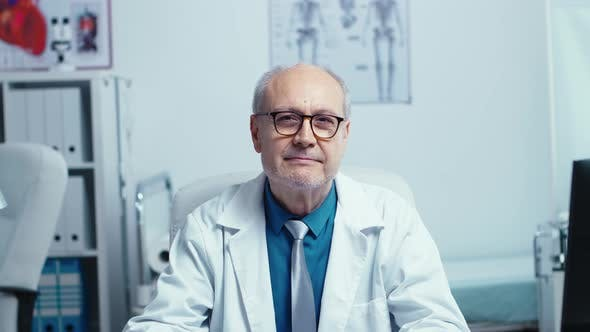 Thumbnail for Authentic Portrait of Elderly Experienced Doctor