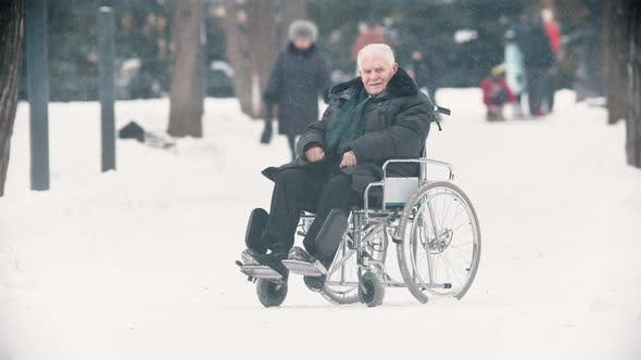 An Old Man Veteran Sitting in a Wheelchair
