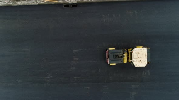Thumbnail for Two Yellow Pavers Ride Pave the Hot Asphalt. Steam in Road. Aerial Drone Shot