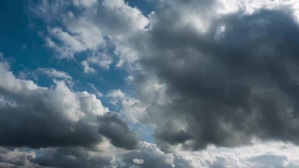 Cumulus Clouds Rolling over Blue Sky