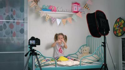 Little Girl Recording Crafting Tutorial Video