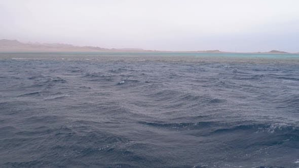View From the Ship on the Waves and the Coast of Egypt in Stormy Weather