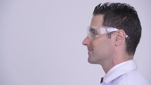 Thumbnail for Head Shot Profile View of Happy Man Doctor Wearing Protective Glasses Smiling