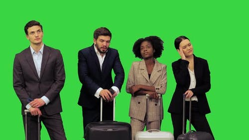 Tired Business People on a Trip Discussing the Further Actions on a Green Screen Chroma Key