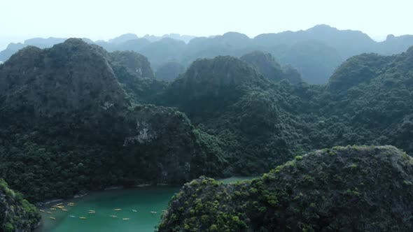 Thumbnail for Aerial: flying over Ha Long Bay rock pinnacles, famous tourism destination in Vietnam