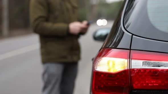 Man Calling Service Having Car Trouble