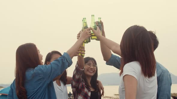 Group of Asia best friends teenagers salute and cheers toast of bottle  beer enjoy party with happy.