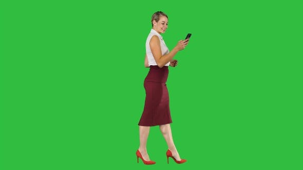 Thumbnail for Beautiful young woman is using an app in her smartphone