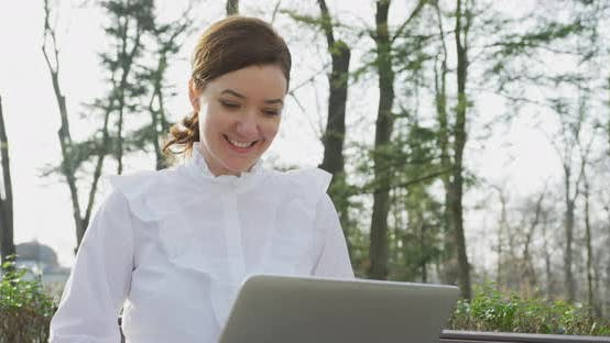 Thumbnail for Woman with laptop in the park