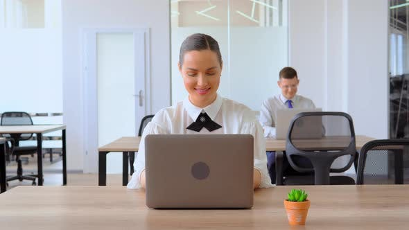 Thumbnail for Portrait Businesswoman Entering Data on Laptop at Workplace