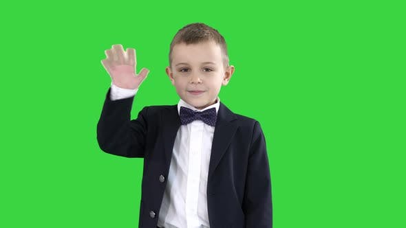 Thumbnail for Friendly Little Boy in a Suit Says Hi and Then Says Bye on a Green Screen, Chroma Key