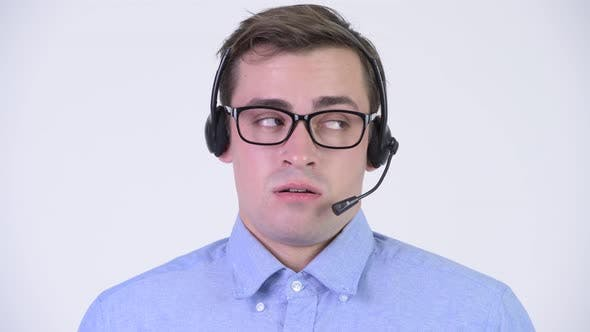 Cover Image for Young Stressed Businessman As Call Center Representative Looking Bored
