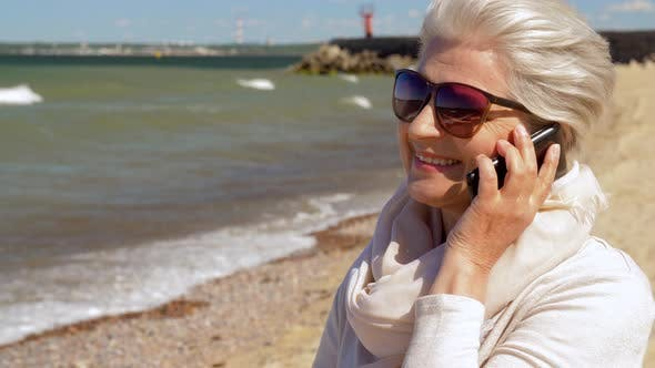 Thumbnail for Senior Woman Calling on Smartphone on Summer Beach