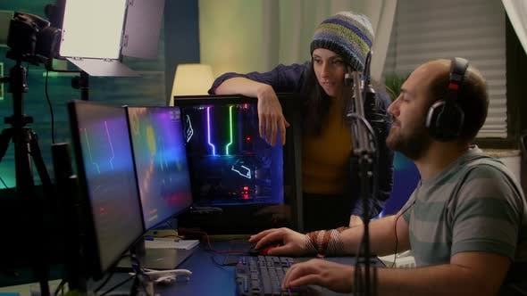 Side View of Pro Streamer Couple Performing Online Video Games