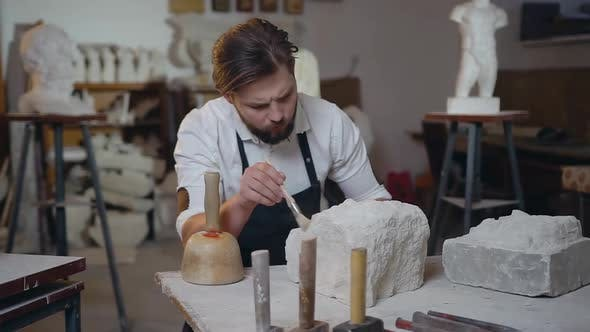 Thumbnail for Sculptor Which Cleaning Down the Remains of Limestone with Brush