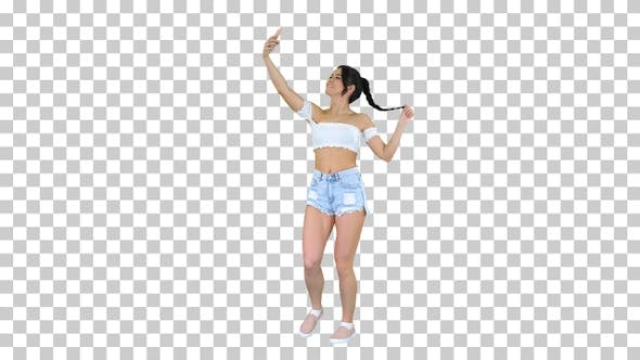 Thumbnail for Cute brunette girl takes a selfie and dancing, Alpha Channel