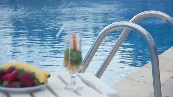 Thumbnail for Refreshing Summer Cocktail, Fruit Near Swimming Pool, Rack Focus