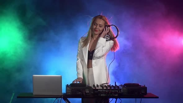 Thumbnail for Beautiful Dj Girl in White Jacket Playing Music and Dancing, Touching the Equipment, Singing, Smoke