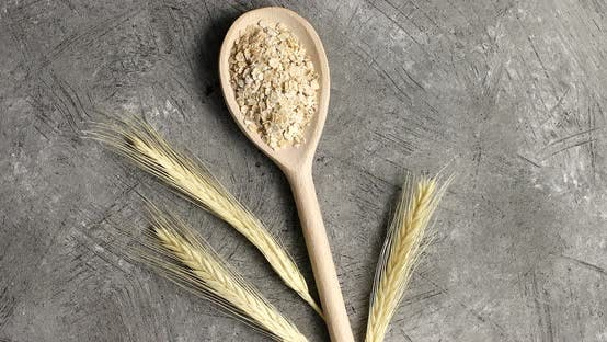Cover Image for Wooden Spoon with Oats on Table