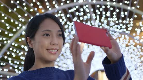 Thumbnail for Woman use of the photo for take photo with the christmas decoration at night