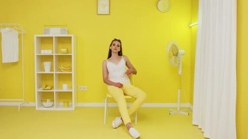 Portrait of Caucasian White Woman Sitting In Yellow Office