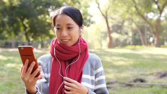 Thumbnail for Woman making video call in the park