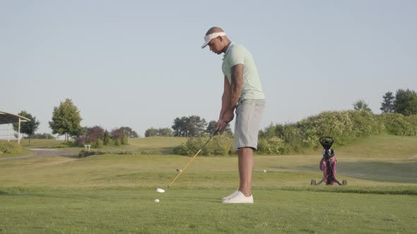 Thumbnail for Handsome Middle Eastern Man Hitting Golf Ball on Beautiful Course