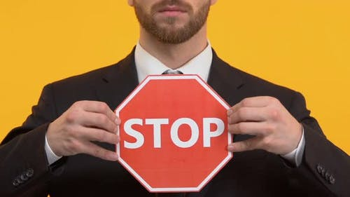 Businessman Holding Stop Sign, Stop Corruption, Taking Bribes by Civil Servants
