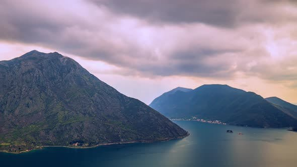 Thumbnail for Adriatic Sea, Boka Kotor Bay, the Movement of Clouds Over the Mountains in Montenegro Timelapse Made