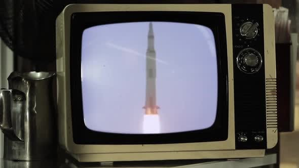 Thumbnail for Apollo 11 Rocket Launch On a Small Retro TV. Zoom In.