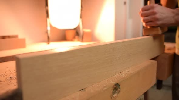 Thumbnail for Carpenter Planing Wood in Slow Motion