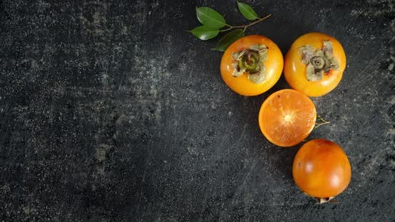 Thumbnail for Ripe Persimmon Roll on the Table.