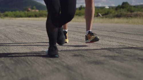 Legs Close Up Slow Motion Fit Couple Jogging Exercising Running Cardio Workout