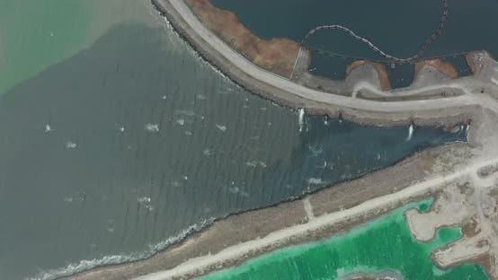 Thumbnail for Aerial View. Drone Flying Forward Over a Polluted Sea with Destroyed Ecosystem. Slag Dump Poisoning