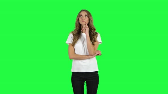 Thumbnail for Lovable Girl Thinks About Something, and Then an Idea Comes To Her. Green Screen