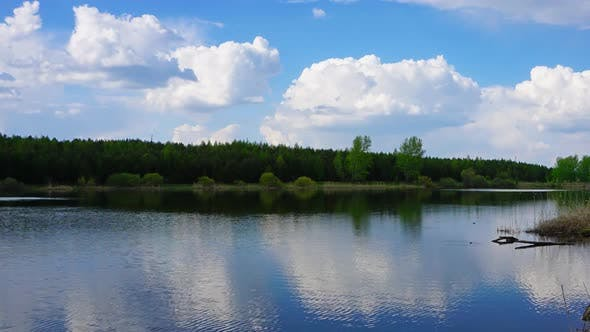 Thumbnail for Clouds in Smooth Water of Lake, Panorama Timelapse