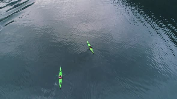 Thumbnail for Two Green Kayaks in Turquoise Water of the Fjord. Norway. Aerial View
